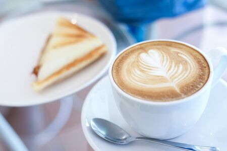 hot latte coffee drink and sandwich put on table breakfast in the morning day