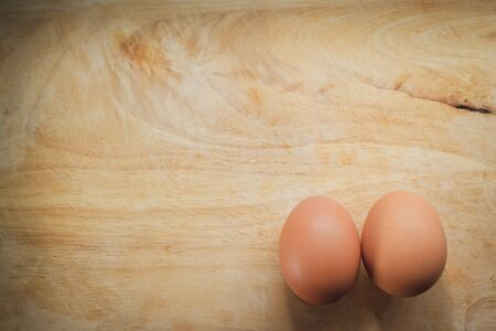 hen egg put on wood cutting board in kitchen prepare cooking Banco de Imagens