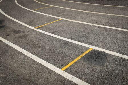 black tarmac asphalt of running track, athletic sport background