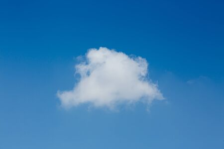 fluffy one white cloud on clear blue sky background 스톡 콘텐츠