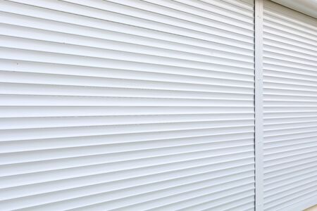 white roller shutter door closed security in modern house Standard-Bild