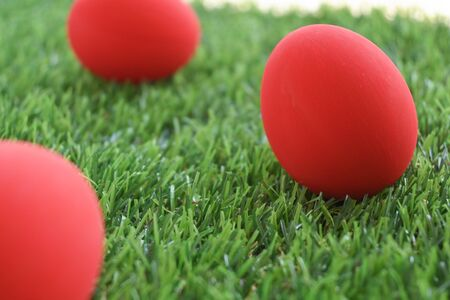 red easter egg on lawn green grass artificial, image of morning springtime concept
