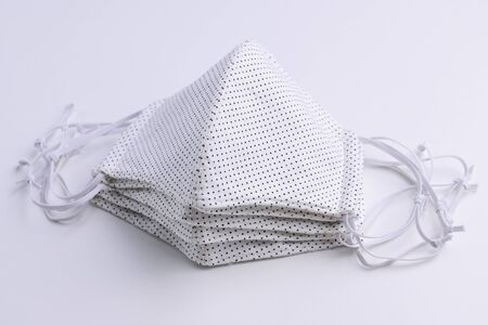design of white face mask handmade sewing from fashion fabric cotton cloth