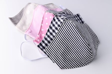 face mask handmade from fashion fabric cloth on white background