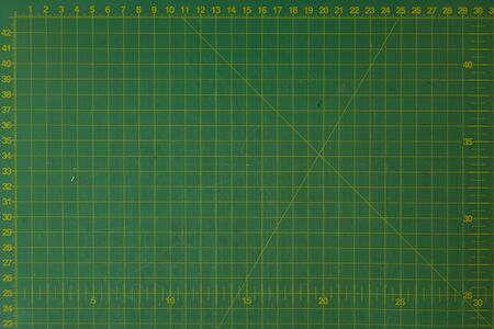 green cutting mat scale with scratch texture from cutter