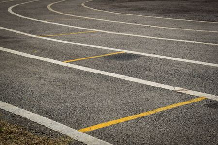 black tarmac asphalt of running track, athletic sport background Archivio Fotografico