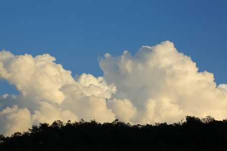 landscape image, large cloud on sky above mountain hill