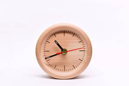 wooden table clock of time, single object isolated on white background Фото со стока