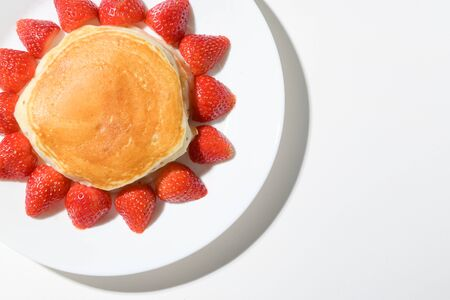 cute pancake strawberry with sun shape on white background Фото со стока