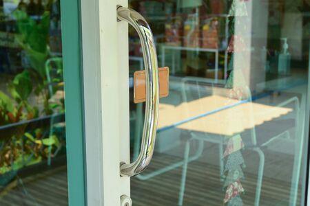 stainless steel handle on glass door Stock Photo