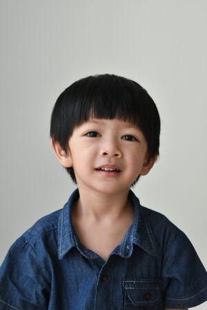 portrait image of happy asian boy smile face on white background Banco de Imagens