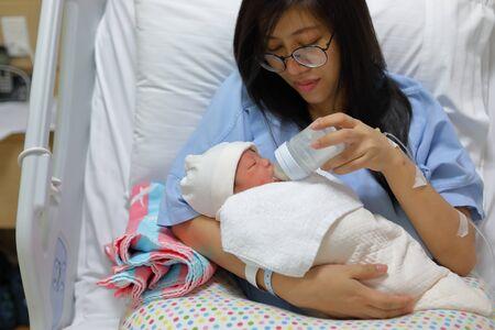 mother parenting, mom using bottle breastfeeding for a baby newborn drink milk