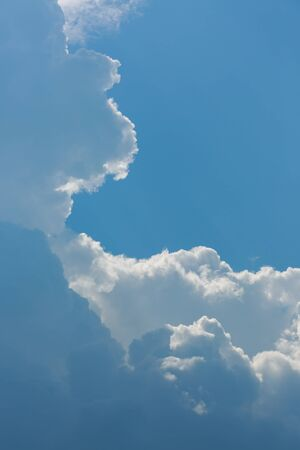 fluffy white cloud above clear blue sky background Banco de Imagens