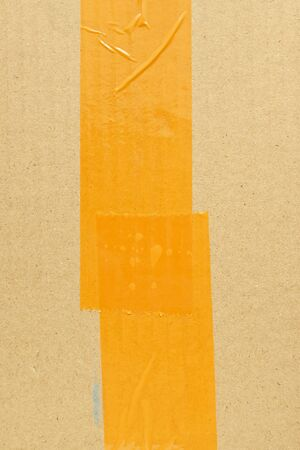 scotch tape stick wrapping on brown carton paper box package of industrial, image used for design background