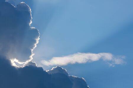 sun light shine through cloud on clear blue sky background