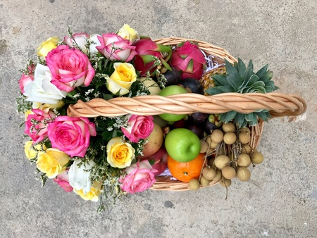 Fruit and flower basket on cement floor