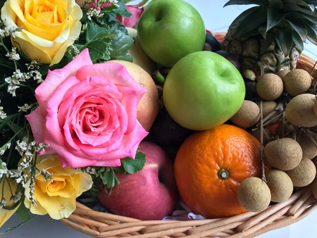 Fresh fruit with roses decoration Stock Photo