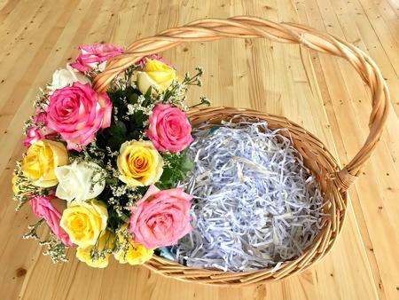 Flower basket with shredded paper