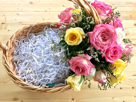 Flower basket with shredded paper