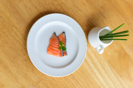 stockphoto: salmon in white dish on wooden