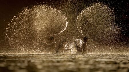 stockphoto: The fun of children With the cool evenings on the river.