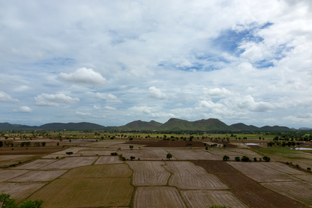 land slide: Fields, mountains and sky, cloud mass at Thamuang Kanchanaburi,Thailand Stock Photo