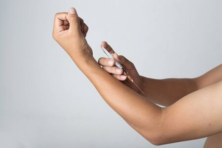 injected: Stance man Injected into the arm Stock Photo