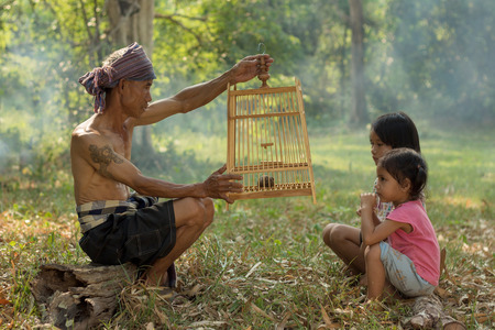way of living: His father taught his children with the animal in a cage. A comparison of living and care. And a way of life in the north eastern region of Thailand.