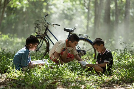 well read: Group children are well read books in the rubber. Stock Photo