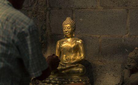big buddha: Hands Cleaning golden Buddha Stock Photo