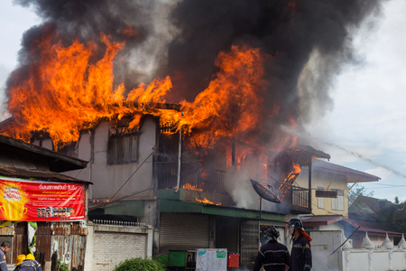 conflagration: Sakon Nakhon, Thailand on September 13, 2015 at 15:00 oclock. conflagration damaged nearly the entire house. Fire officials estimated the cause of the short circuit.