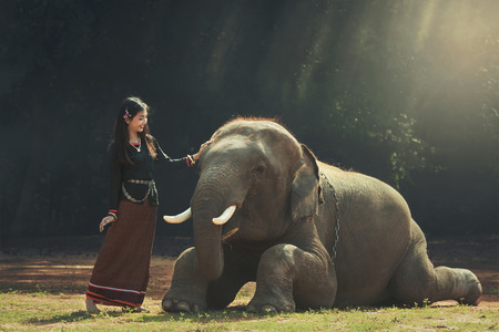 frienship: Asia,thailand The girl and the elephant Stock Photo