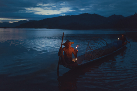 mekong river: Asia,Fisherman on evening time Lamplighter at the mekong river