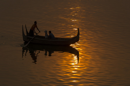 boatman: Burmese boatman with Tourism on the sunset silhouette