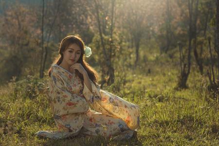 close your eyes: japanese kimono beautiful woman  on sakura garden.