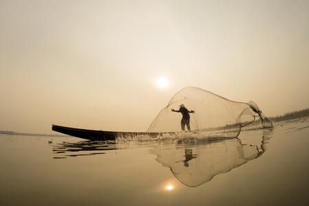 fishingnet: Asian, Fisherman action on the boat fishingnet.