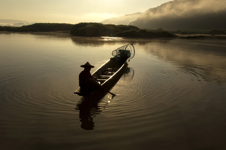 fishermans net: Lifestyle the morning of fishermen in the Mekong River. Stock Photo