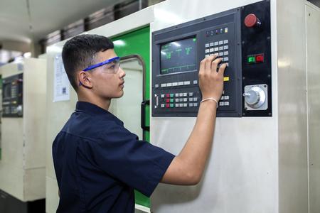 cnc machine: Man programming CNC machine