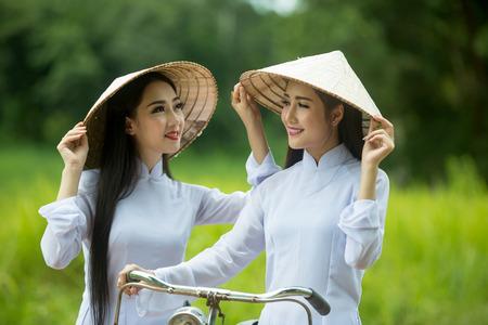 ao: Women in vietnam ao dai traditional dress
