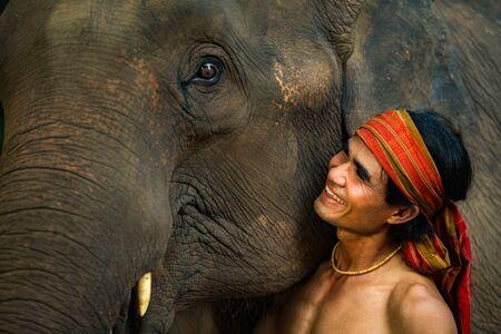 face close up: Close up face elephant and Mahout man
