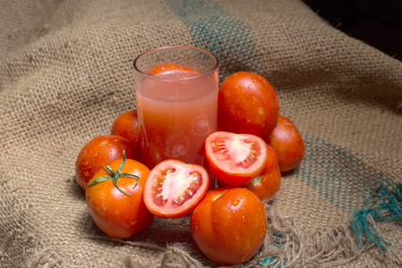 Red Tomato juice placed on a hemp sack