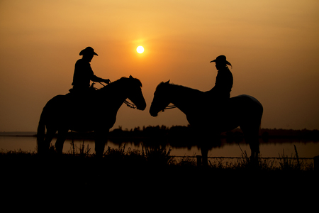 Silhouette Cowboy on horseback and enjoy the sunset.