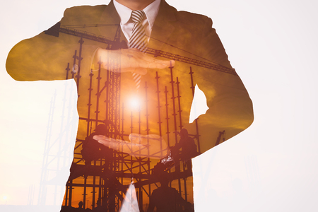 Double exposure business action modern digital motion graphics construction development to smart city