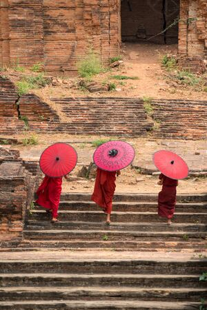 Novice monks walking together in ancient temple Mandalay Myanmar. Stock Photo