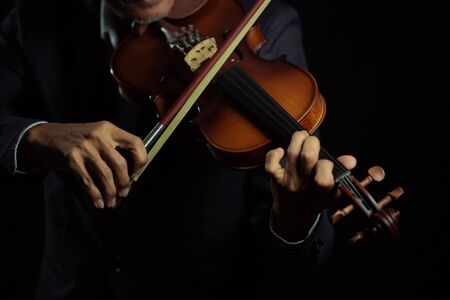 Violinist player hands close up shot in black isolated background 版權商用圖片