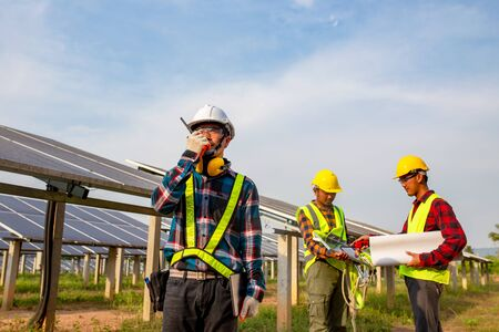 The electrician engineering working in the solar cell farm Stock fotó