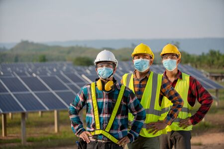 The new normal of the electrical engineering team is working in a solar panel farm or repair photovoltaic Stock fotó