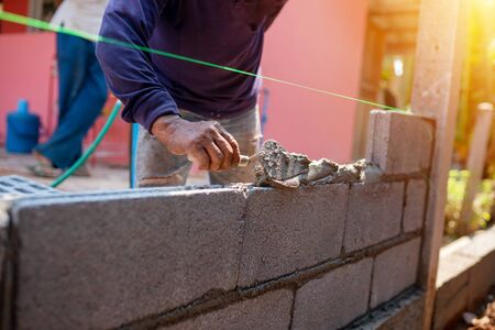 Techniques for cement masonry for the construction of building fences Stock fotó