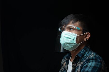Close up portrait man wear a face shield and mask for outbreak Coronavirus or Covid-19, New normal concept Stock fotó