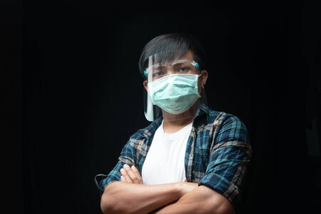 Man wear a face shield and mask for outbreak Coronavirus or Covid-19, New normal concept